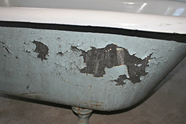 Step-by-step guide on how to clean and paint an old clawfoot tub.