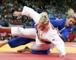 Kayla Harrison of the U.S. fights with Britain's Gemma Gibbons (blue) during their women's -78kg final judo match at the London 2012 Olympic Games August 2, 2012. - http://www.PaulFDavis.com/success-speaker (info@PaulFDavis.com)