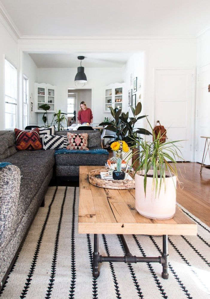 Tweed couch, rustic coffee table and aztec pillows making this living room amazing!
