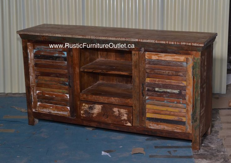 """Crafted from recycled wood solids in a multi-colored hand-painted finish ensuring bonafide originality, this Tv stand or side board offers the faded colors of an heirloom as well as an alluring rustic charm.  http://www.rusticfurnitureoutlet.ca/recycledwoodfurn.html 59""""L x 31""""H x 19"""" D cost 479$"""