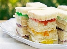 Rainbow Cream Cheese Sandwich Bites:  12 slices white sandwich bread.  whipped cream cheese.  a rainbow selection of jams/jellies/preserves such as strawberry, marmalade, lemon curd, mint, etc)
