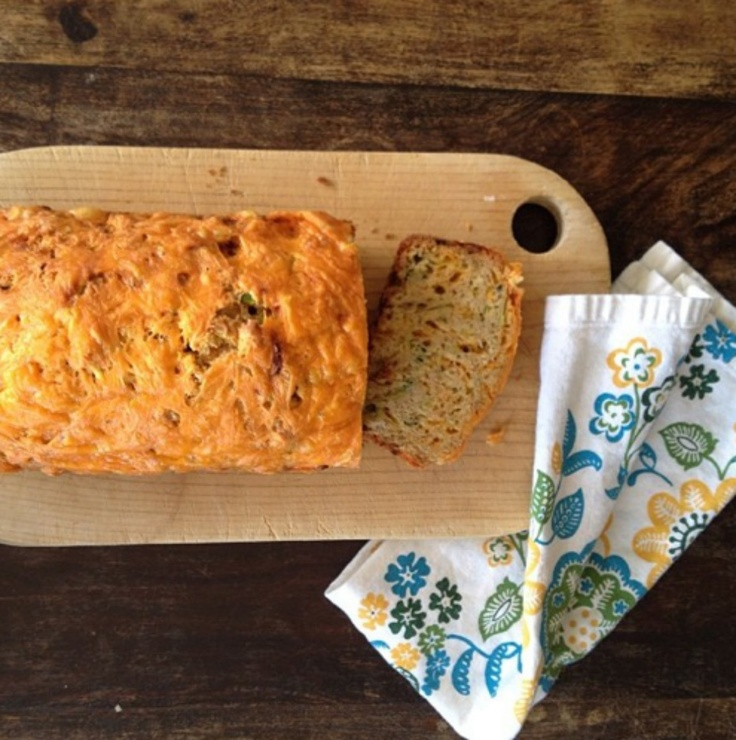 Wendy Underwood cuts the first slice of our Sharp Cheddar-Zucchini Bread.