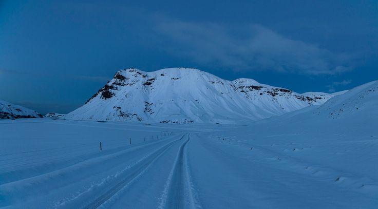 Mountain near Vik before dawn. - Snow capped mountain near Vik in the blue hour.