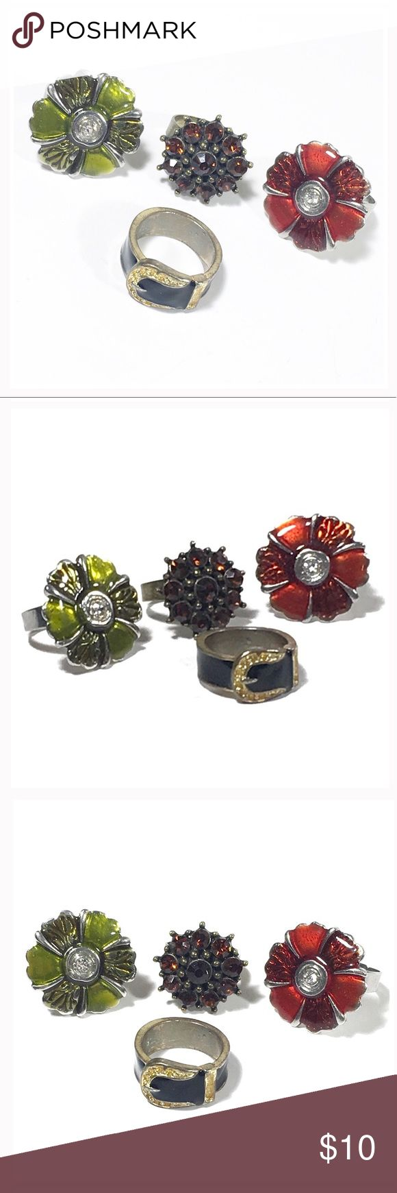 4 Rings These four rings will add a fun touch to any outfit. Three are adjustable. The black and gold belt ring is a size 6.   Posh Mishmosh 🌺 Jewelry Rings