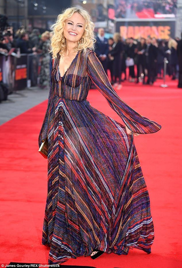 Malin Akerman stuns in a semi-sheer gown at UK premiere for Rampage
