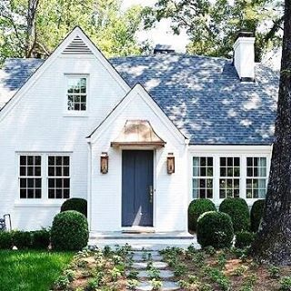 Thinking about this cute cottage tonight. Give me all the painted brick! ❤❤❤ Designed by @amandaorrarchitects