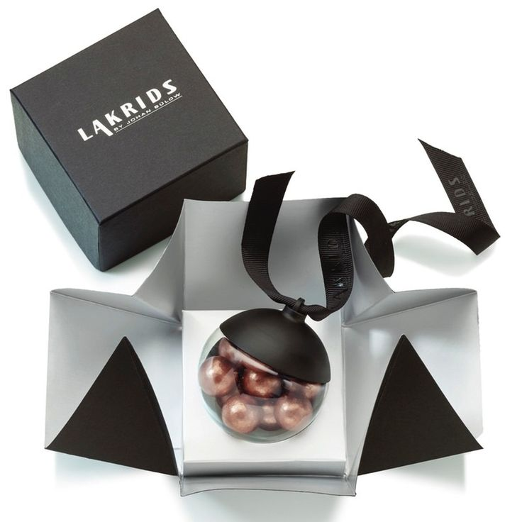 Lakrids by Johan Bülow, are delicious little confectionery balls of delight. Dressed to impress,bronze is this seasons 2016 gem with a sweet and salty combination, soft liquorice and silky smooth dulche de leche caramel chocolate,crispy seasalt and a punch from their own raw liquorice powder, a perfect tickle to your tastebuds! Perfect little balls of shimmering bronze confectionary 72 gram decorative ball to indulge and delight with a gourmet taste. Perfect for hanging on your Christmas…