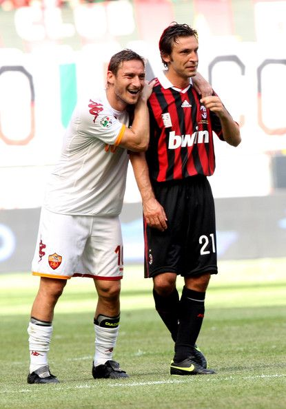 Pirlo with Francesco Totti
