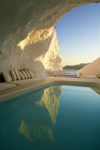 I'd love to have this white rock cave room with the cool, blue pool!! DREAMY.
