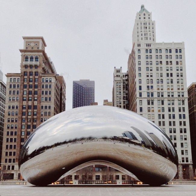 "Cloud Gate -- referred to by locals as ""The Bean"", for obvious reasons -- is a public sculpture by talented British artist Anish Kapoor. Cloud Gate weighs in at over 110-tons, and is 66 feet long and 33 feet high. ""The Bean"" was created using a huge number of individual stainless steel plates -- Cloud Gate's seamless surface is the result of thousands of hours of polishing. (Chicago)"