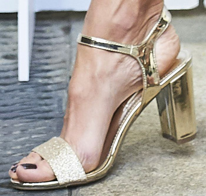 Alessandra showcases one of her designs from the Spanish shoe brand Xti