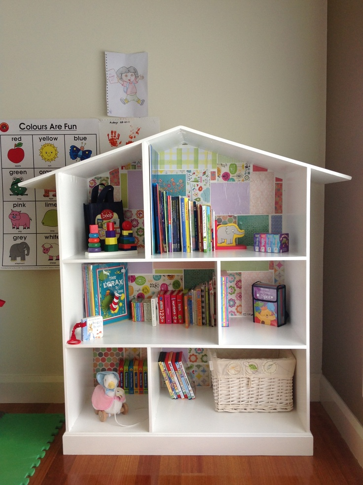 Bookshelf in the kids play room. Marc built it, I did the backing and filled it.