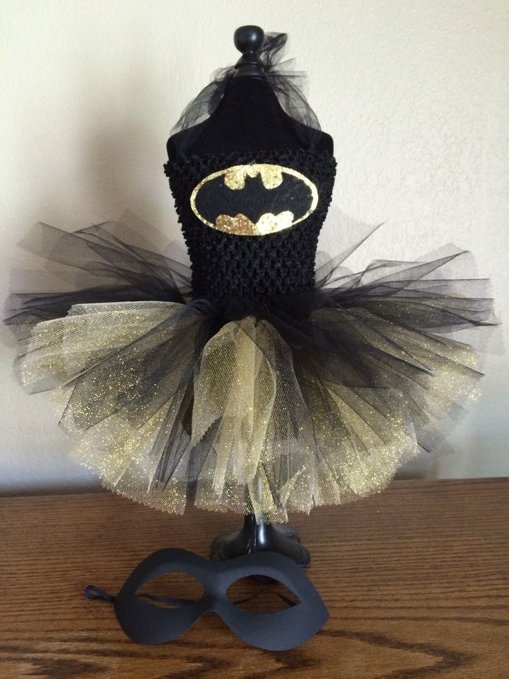 A personal favorite from my Etsy shop https://www.etsy.com/listing/200596734/batgirl-tutu-dress-halloween-costume Www.facebook.com/tinytoestutuboutique Www.etsy.com/shop/tinytoestutuboutique Designer Christy Cantrell 817-805-8634