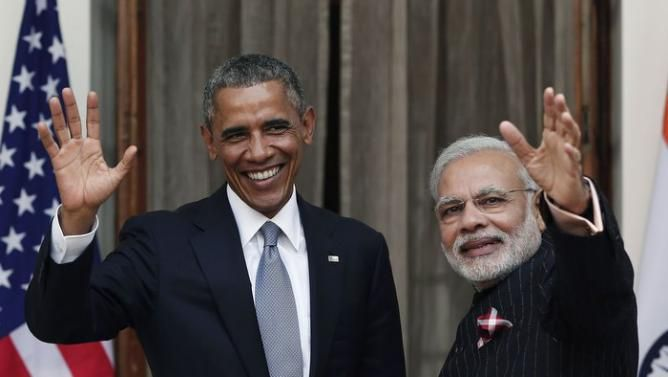 President Barack Obama and Prime Minister Narendra Modi wave ahead of their meeting at Hyderabad House