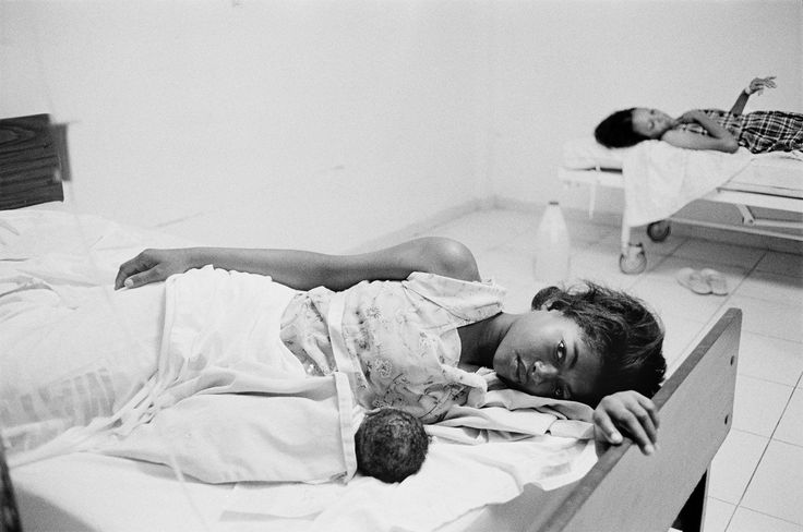 A patient with her newborn baby at Hospital Juan Pablo Pina in san Cristoba, Dominican Republic. The hospital lacked hot water and consistent electricity.