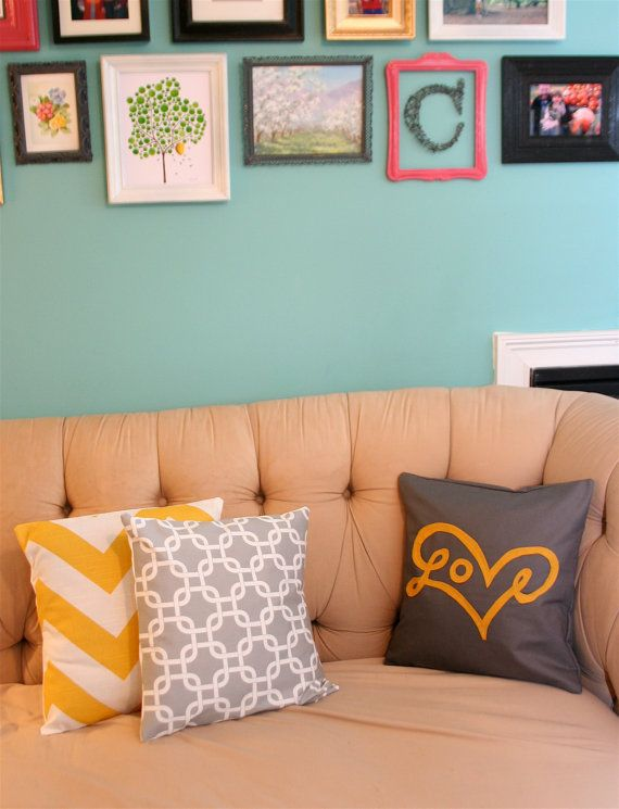yellow and grey accent pillows. love the wall color too though!