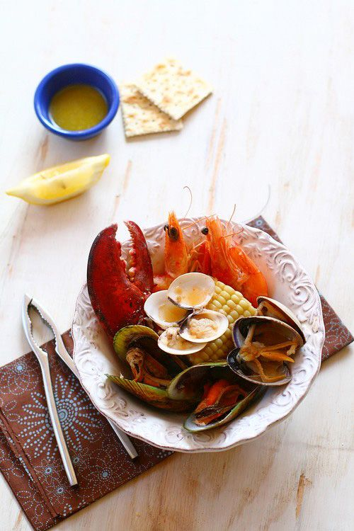 One outstanding recipe that truly showcases the abundance of New England's seafood harvest is the Clambake.