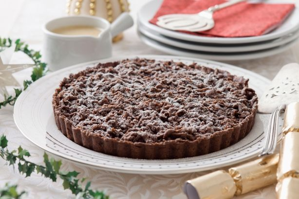 Full of spice and lip-smacking sour cherries, this decadent Christmas tart pairs perfectly with homemade custard.