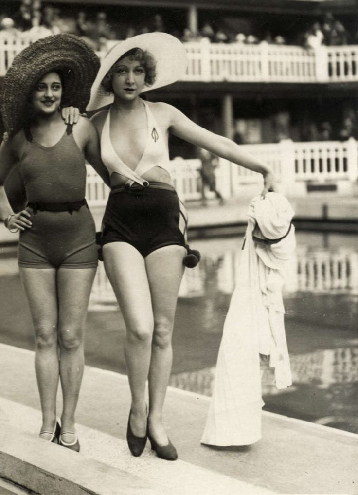 1930's bathing beauties.  The one with the low neckline was especially daring for the time.