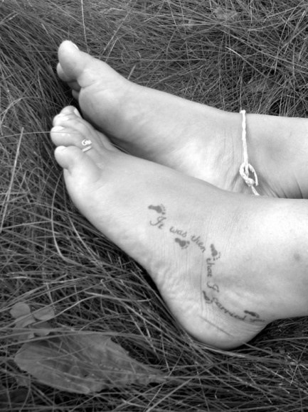 Footprints in the sand foot tattoo .
