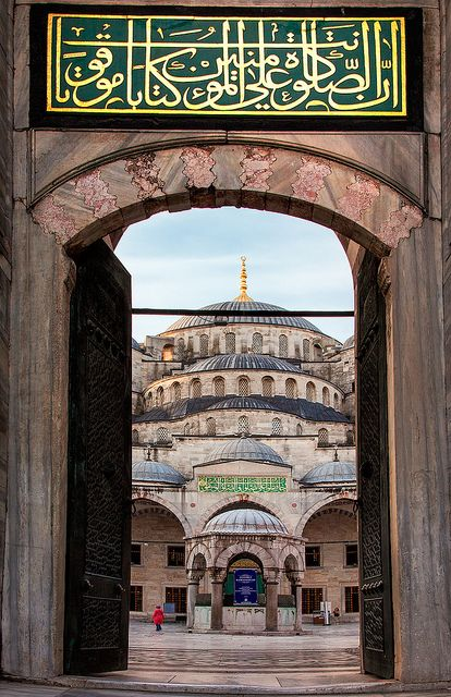 A doorway frames the Blue Mosque