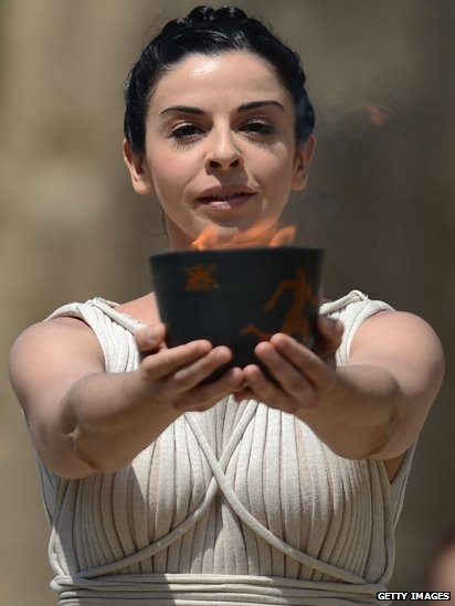 Women dressed as vestal virgins acted as guardians of the flame during the lighting ceremony. The torch, specially made for the lighting ceremony, was used to transfer the flame to the archaic pot which was taken via an ancient pathway to the site of the first Olympic Games. #Skyirace #Dress #Olympics