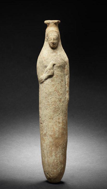 A Rhodian terracotta figural alabastron Archaic, circa 6th Century B.C. Goddesses often hold birds or have birds on their heads.