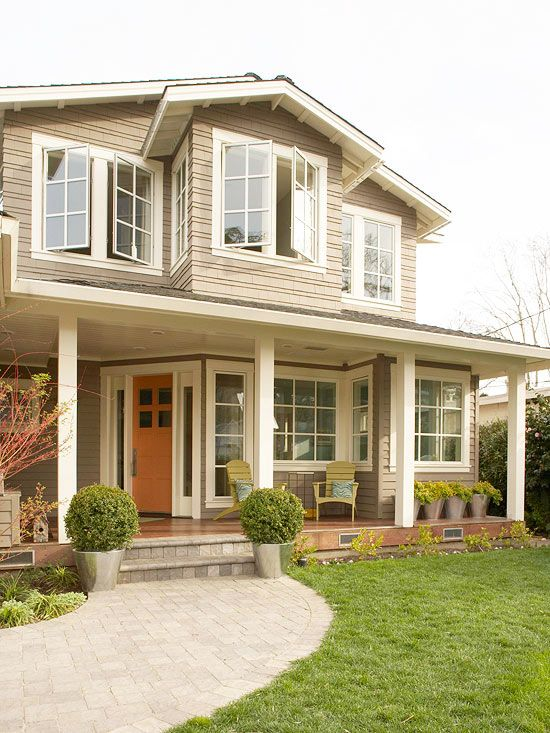 Build a Path from driveway to the front door steps.  I like how this one is curved.  Also, think about replacing the really large front windows with ones that are just as wide, but not as tall so that there is more siding near the deck.