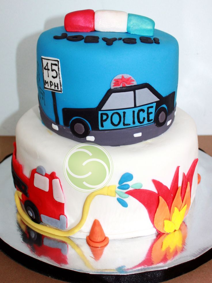 "Police Car and Fire Truck themed 5th Birthday - When a mom asked me to do a police car and fire truck themed birthday cake (originally 3d), I was confused! Wouldn't a Police man and Fire Fighter be easier!? LOL. not the case! this is a 6"" & 8"" stacked cake all done in fondant. This is an original design as I had very few photos to go off of for a combined theme like this. My husband and I worked on this together and we're very proud of this cake!"