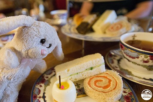Bunny enjoying an authentic British Afternoon Tea experience, complete with scones, pastries, savories and tea sweets at the Fairmont Empress Hotel.
