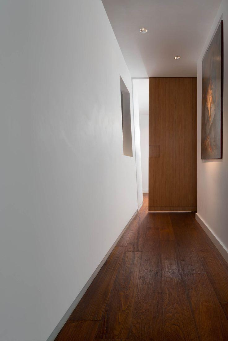 Abitazione privata, Casa V.le Tiziano, corridoio con porta scorrevole, Progetto Arch.Luca Braguglia