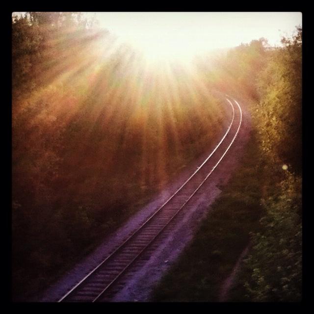 Railroad under sunset
