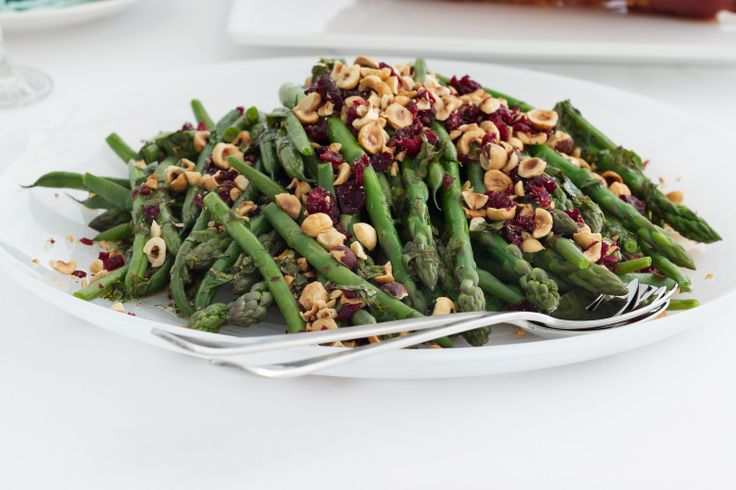 Asparagus and green beans dressed with hazelnut and cranberry is the perfect side for big festive get-togethers.