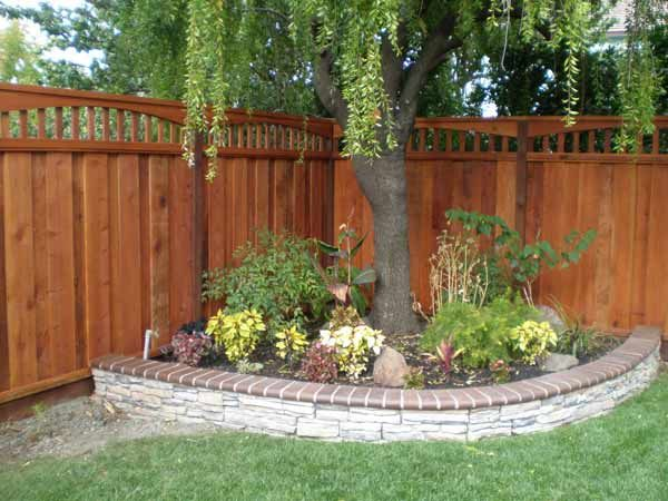 Design Trends For 2014 And Tips For Fence Building Or Replacing In 2021 Corner Landscaping Fence Landscaping Backyard Landscaping