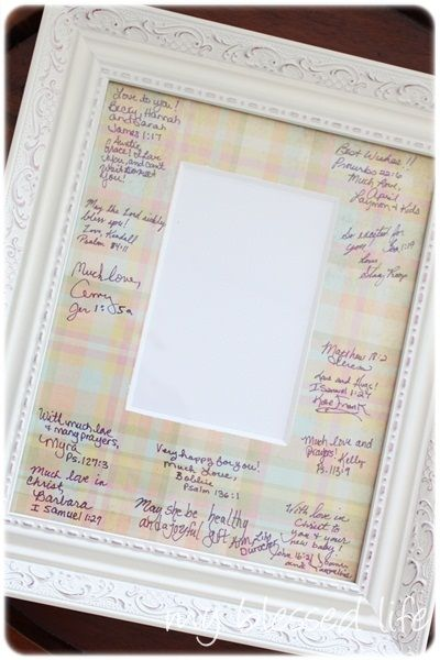 "frame with mat covered in scrapbook paper as a ""guest book"" for a baby shower.  Mom can put a picture of the baby in the frame to show how much love people had for him/her before they were born"