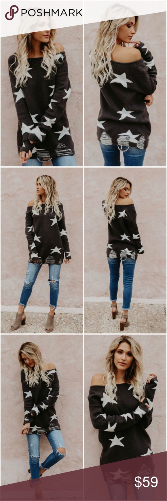 """🆕Ari Distressed Star Sweater in Charcoal The charcoal hue combined with ivory stars throughout this sweater creates a bold contrast that would be perfectly stylish with black skinnies and black booties for a little edge!  Distressed Hemline Unlined  Size Small: 31"""" from shoulder to hem (S M L available) 65% Acrylic, 25% Nylon and 10% Polyester Model is 5'7"""" and wears a Small A Mermaid's Epiphany Sweaters"""