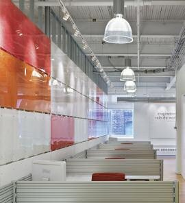 Colourful plexiglass panels with steel studs make effective space dividers