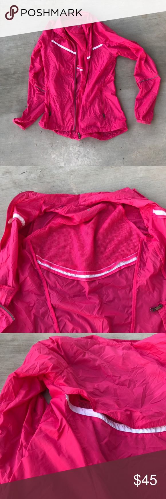 Hot pink Nike running jacket Super light weight waterproof running jacket. Mesh linking on the inside for your back and a few small openings in the back that keep cool. Color is a little more neon than the picture shows. Feels like a parachute material and is perfect for cooler temps. Two zippered side pockets and full zipper down the front. Excellent condition only worn a few times. Nike Jackets & Coats Utility Jackets