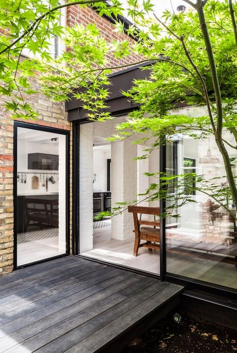 Kirkwood McCarthy has added a black zinc-clad wing to the rear of a London house, creating a light-filled living space that sits between the garden and a new courtyard