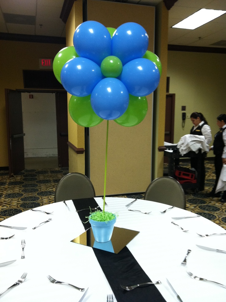 Flower balloon centerpiece in a pot base
