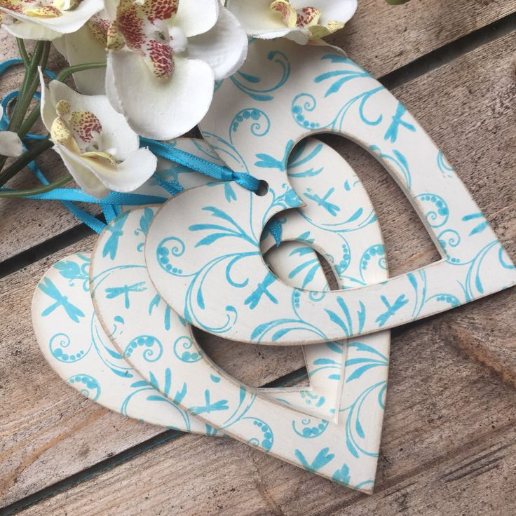 A personal favourite from my Etsy shop https://www.etsy.com/uk/listing/478779300/blue-hearts-decorated-wooden-heart-blue