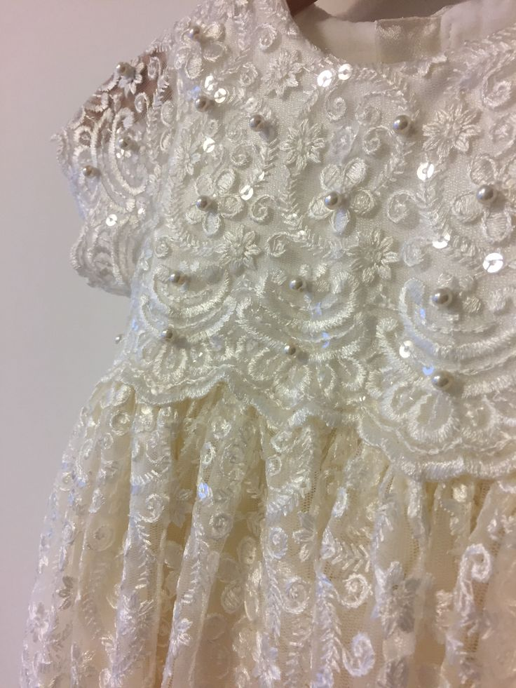 Sequin and lace Christening gown with intricate pearls | Bisou Baby #christeningdress #babychristeningoutfit #bisoubaby #lacedress #baptismoutfit #babygirl