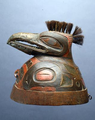 centuriespast:    Tlingit War HelmetTlingit helmets had carved spirit, ancestor or clan crest figures that spiritually protected and empowered warriors for battle. Only outstanding warriors or leaders wore such elaborate helmets. The war helmet on the left represents a red-breasted merganser, a swift and aggressive seabird. The other helmet may represent a mouse, marmot, or other rodent. War helmets are unique to Tlingit culture  1750-1800  The Fenimore Art Museum