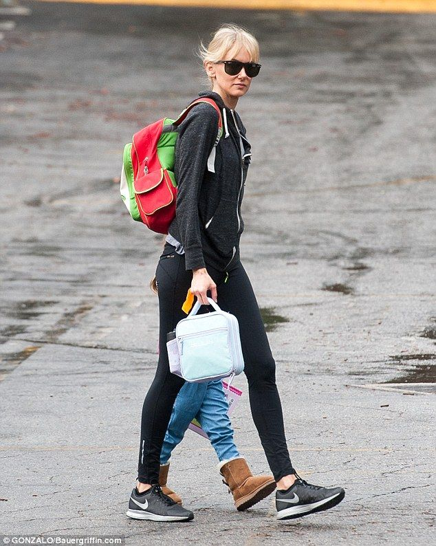 Kimberly Stewart holds hands with daughter Delilah on schoolrun  #dailymail