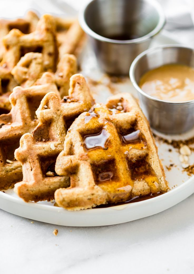 Flourless Peanut Butter Waffles are easy to make and rich in protein! Light, fluffy, dairy free, delicious! Freezable for meal prep or breakfast to go!