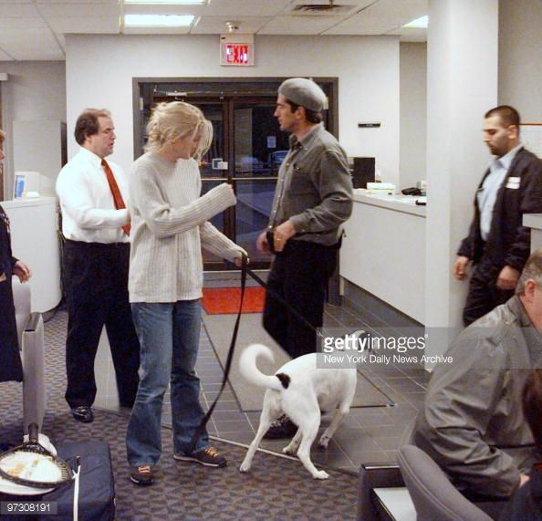 John Kennedy Jr. and wife Carolyn Bessette Kennedy, with dog, at Teterboro Airport.