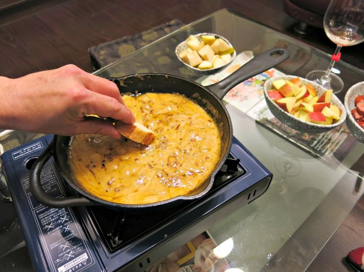 Whiskey Cheese Fondue Recipe By The Tabletop Cook Slices Of Baguette Make Excellent Cheese Fondue