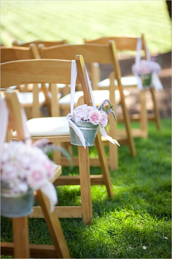 wedding aisle decor ideas (and I have the pails & tulle already) add babys breath & other flowers for color