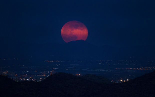 I see a supermoon rising over the city of Tucson.