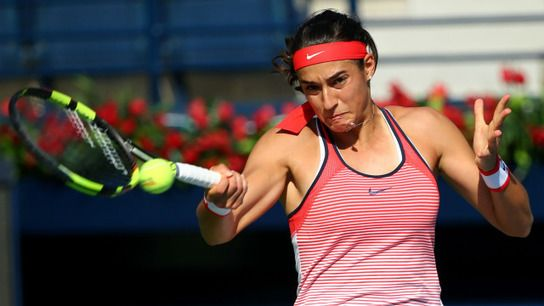 Caroline Garcia claimed her first grass-court title at the inaugural Mallorca Open on Sunday and earned a seeding for Wimbledon in the process. A 6-3 6-4 win over Latvia's Anastasija Sevastova ensures Garcia - 39th in the WTA rankings at the start